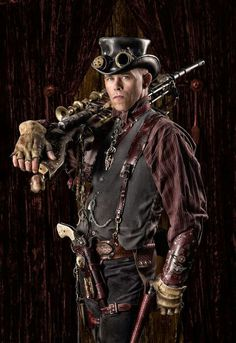 Steampunk man - seems like a railroad worker or something from the gloves, although the guns make me think wild west outlaw