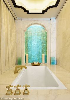 Bathtime to remember: A sunken bathtub in one of the ensuite bathrooms inside the luxury h...