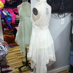 White Lace Dress by Guess This gorgeously gauzy white halter dress with a lace back panel by Guess is perfect for a warm breezy day! The elegant handkerchief hem line adds a bit of feminine whimsy. If I could fit in it I would live in it, the fabric is so soft! Guess Dresses