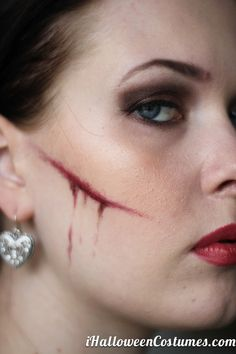 A fake cut made by make up ( just eyeshadow ) and fake blood easy ...