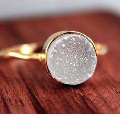 white agate druzy stone set in hammered vermeil gold.