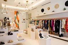 tenoversix store - Love the hats on the wall, and the heights of tables