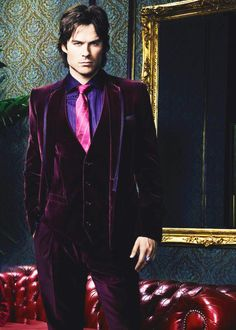 Men's deep burgundy three piece suit.