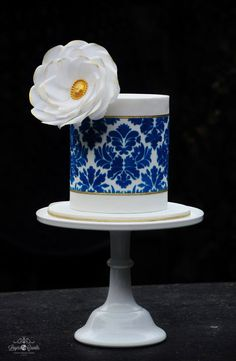 Royal Blue and White double barrel cake with stencils and  a wafer paper flowers ~ all edible