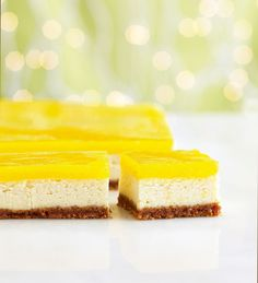 Lemon Shimmer Cheesecake Squares—Tart lemon curd gives these zesty cheesecake squares a stunning mirror-like finish. Scrape down the sides of the bowl often for a perfectly smooth filling.