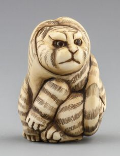 "JAPANESE CARVED IVORY NETSUKE TABBY CAT Japanese carved ivory netsuke of a fat tabby cat. Signed. Size: 1.5 x 1 x 1"" Weight: 29g Estimate	$100 – $200 Auction 10:00 AM - Mar 10, 2013"