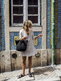 Summer Style | White cotton dress + black straw tote + sliders via Fashion Me Now