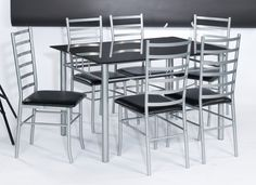 Bonsoni is proud to present this Lincoln Dining Set - Black Glass Round by Lloyd Phillip & Delric which has Assembled Dimension: table 900 x 770 chair 485 x 395 x 990. The ever popular Lincoln dining set is available in black or clear glass with four faux leather chairs.  http://www.bonsoni.com/lincoln-dining-set-black-glass-round-by-lloyd-phillip-delric
