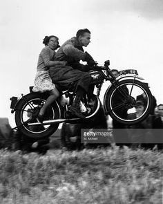 A young motorcyclist taking a pillion passenger for a ride at the Eltham Motor Cycling Club in London.