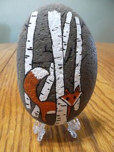 Fox in the Forest Acrylic and Acrylic pens on Local river rock. Sealed with artist initials on back. Measures roughly Holder not included, sorry. Rock packages in a flat rate priority box with bubble wrap. Pebble Painting, Pebble Art, Stone Painting, Painted River Rocks, Hand Painted Rocks, Painted Pebbles, Painted Stones, Stone Crafts, Rock Crafts