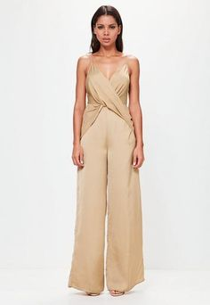 introducing the SS17 peace + love collection. this is next level premium for the confident statement-breakers.   Get all wrapped up in this tan jumpsuit - featuring a knot style front, nude undertones, relaxed fit and plunge neck. You'll ...