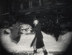"""""""Woman with Broken Umbrella"""" by Weegee."""