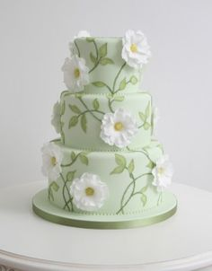 Spring, spring, spring! This soft green cake with delicate, white sugar flowers is my favourite cake on this board. From The Cake Parlour, London.