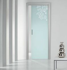 I love the idea of a frosted glass pocket door with a contemporary design etched into the glass...this would look great as an entrance to the spa section of the salon :-)