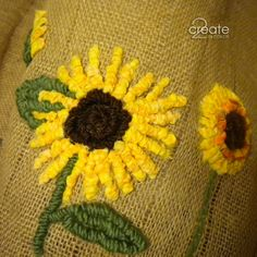 Locker Hooking sunflowers on burlap for a vase cover this fall.