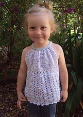 So pretty! You'll want to crochet this adorable top for your little girl's warm weather wardrobe.