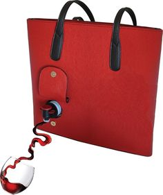 A wine purse, with a built in cooler, and dispenser, because hey...why not? There's something about this that absolutely TERRIFIES me! LoL!!!