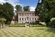 Such a gorgeous historic country house - the grass is even fancy!