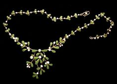 MRS. NEWMAN. (1840-1927) MISTLETOE NECKLACE.  An Arts & Crafts gold enamel and pearl necklace.   Marked 'Mrs. N'. English circa 1895.