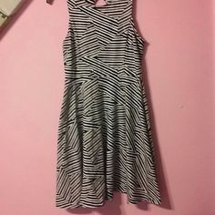 Fun Black and White Zig- Zag Designed Dress This fun dress is very full in the skirt for those who love to twirl.. Gently worn and cared for. . Great condition. .   Open hole at top with button at top.  Fun and frilly. Xhilaration Dresses
