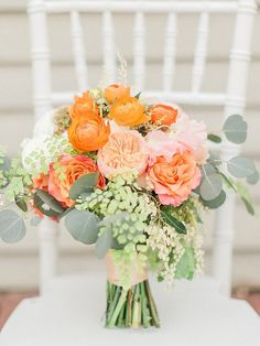 peach and orange bouquet - photo by Trini Mai Photography http://ruffledblog.com/vibrant-summer-wedding-inspiration #weddingbouquet #flowers #bouquets