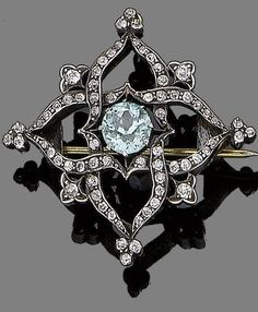 Victorian. Gold, Silver, Blue Zircon and Diamond Cross Brooch, c1890.