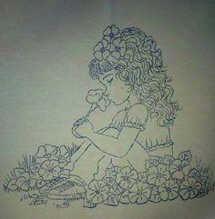 Niña sentada en flores: