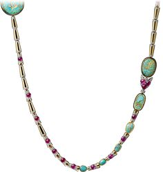 CARTIER. {Close up} Long necklace - yellow gold, platinum, thirteen carved ancient turquoises totalling 53.35 carats, cabochon-cut rubies, brilliant-cut diamonds. #Cartier #CartierMagicien #HauteJoaillerie #FineJewelry #Ruby #CarvedTurquoise #Diamond
