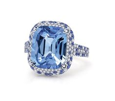 Martin Katz - Blue sapphire ring set in platinum surrounded by microset trapezoid diamonds and sapphires.