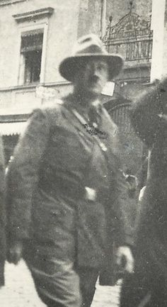 Uncommon photo of Hitler, circa 1929. The man to his left is usually identified as Ernst Roehm, but it is not. Hitler very rarely wore this uniform jacket or this belt.