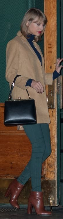Tan coat, black handbag, blue turtle neck sweater, brown leather boots, and green skinny jeans