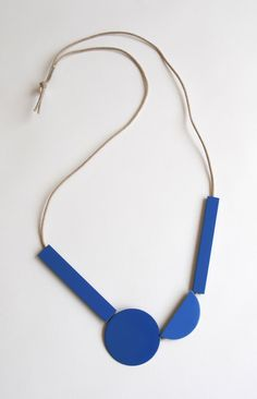 Meredith Turnbull, Hanging Sculpture Necklace, 2013, Powdercoated brass, waxed cotton cord and sterling silver