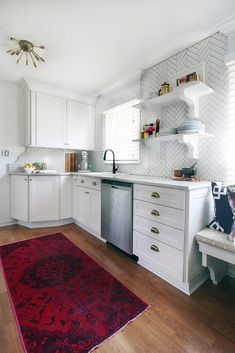 White kitchen with modern chandelier, raspberry rug, chrome appliances and bright natural light but darker floor stain Small Space Living, Small Spaces, Kitchen Decor, Kitchen Ideas, Kitchen Designs, Kitchen Small, Small Kitchens, Kitchen Paint, Open Kitchen
