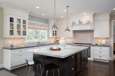L shaped kitchen idea with grey countertop mosaic tiles backsplash shaker cabinets white cabinets dark wood kitchen island with white top a couple of modern black stools of Tens of Inspiring Kitchen Islands with Storage and Chairs