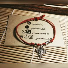 red string bracelet with charms elephant and target by Tibetan silver. by BodhichittaBySB on Etsy