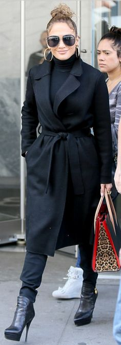 Who made  Jennifer Lopez's black sunglasses, leopard tote handbag, and platform ankle boots?