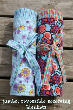 Easy, Jumbo, Reversible Receiving Blanket (HAPPY HOOLIGANS) - great for baby and for wrapping a toddler up after the bath.  Nice and big to tuck around baby in the stroller and carseat as well.  If you can sew a straight line, you can make these.