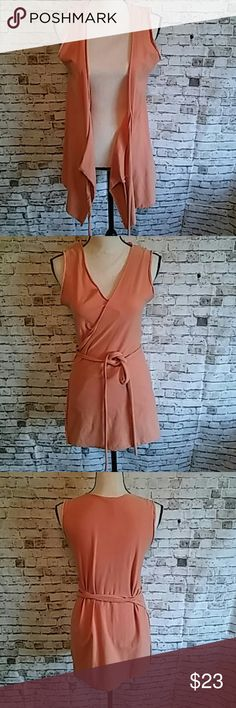 Burnt Orange Wrap Vest/Tunic Bought from local boutique that has fair trade specialty items. Beautiful, soft, eco-friendly company - you can't go wrong with this piece. Perfect for festival season, great layering piece, and nursing friendly! Conscious Tops