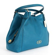 """Coach Refined Pebble Leather Edie Shoulder Bag Style number: 33547, color: teal.   100% authentic. Used a few times. Like new, no any wear at all. Ratail $375+ tax      Magnetic snap closure on top. Light gold plated hardware 3 Main compartments,with a zip pockets & 2 slip pockets The middle compartment with zip closure and turnlock closure COACH logo on the side Hang tag and fibric lining teal pebbled leather COACH logo button at front Double handles with 10 1/2"""" drop for shoulder wear…"""