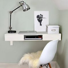 Wall mounted desk. Perfect for a work area in a small space. Plenty of storage for your office essentials in the two drawers and one central open