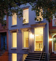Brooklyn Brownstone Passive House   Fabrica 718 designed this Passive House-certified remodel of a late 19th-century brownstone in Brooklyn. The degraded brownstone face veneer was replaced with an EIFS system, and original wood molding details were replicated in fiberglass. Photo: Hai Zhang