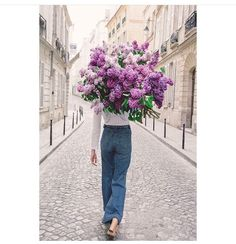 A beautiful lilac bouquet from Young girl in Bloom flower limited edition series on the streets of Paris by Carla Coulson. This one is called On My Way.