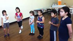 Rocio Ponce teaching flamenco compas to Kids in Boyle Heights