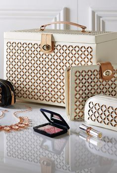 """As sophisticated as a designer """"It Bag,"""" our Laser Cut Leather Jewelry Box is a must for the woman who wants to keep precious accessories safe and neat at home or on the road."""