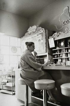 WILLIAM EGGLESTON :: 1960-72, Woman at counter. Although she looks alone, I like the way that Eggleston has made it feel as if she wants it that way. Everyone has a different 'way' of doing cafes - people either like to come and go, or they make a morning out of it. Working, reading, relaxing.