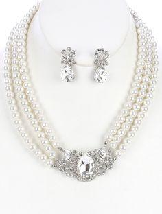 SIZE 16 INCH LONG COLOR White  DESCRIPTION NECKLACE AND EARRING SET FACETED GLASS STONE THREE STRAND PEARL PAVE CRYSTAL STONE METAL SETTING POST PIN 16 INCH LONG 1 1/4 INCH DROP NICKEL AND LEAD COMPLIANT