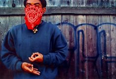 """Asian gang member """"Slick"""" flashes his gang signs.Slick, 24, is Cambodian-American and has been a member of a gang for twelve years.  Photograph by Juanito Holandez  Photograph courtesy of the Long Beach Press Telegram"""