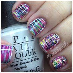 RETRO NAILS      Dip a fan brush in polish (put polish on aluminum foil so it doesn't dry fast) and brush it across nail. in between every color clean the brush with pure acetone and dry it