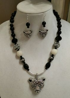 Leopard silver and black. Silver, black, white beads. Necklace and earrings set.  Gorgeous.
