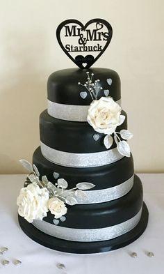 Bespoke wedding cake, black and silver wedding cake, heart topper, ivory sugar paste roses